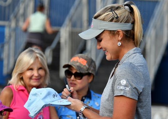 Lexi Thompson signs a autograph after her second round of play during the 2019 CME Group Tour Championship at the Tiburón Golf Club in Naples, Friday, Nov. 22, 2019.
