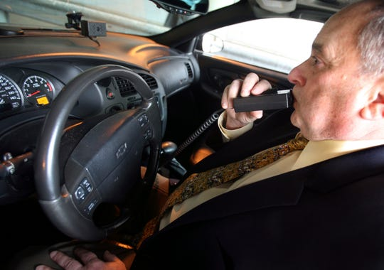 New Jersey's new drunk driving law requires motorists convicted of DUI to install in-car breathalyzers.