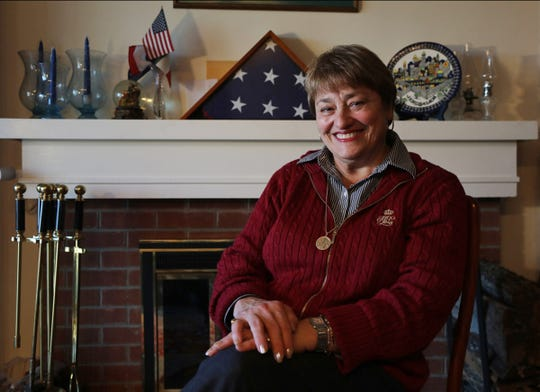 Supporter of President Trump and former head of the Somers Republican Party is Rosalie Cicogna, in the living room of her home by a flag that flew over the capitol in Washington DC and covered her father's casket who had served in World War II. The town of Somers survives as one of only two Republican districts in Westchester County, NY.