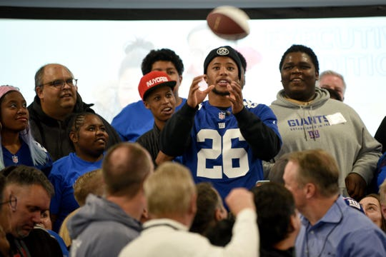 Covenant House holds a Sleep Out Executive Edition in Newark on Thursday November 21, 2019. Covenant House kids and fundraisers prepare to take a photo with Saquon Barkley a player with the Giants and Sleep Out: Executive Edition Chairman.