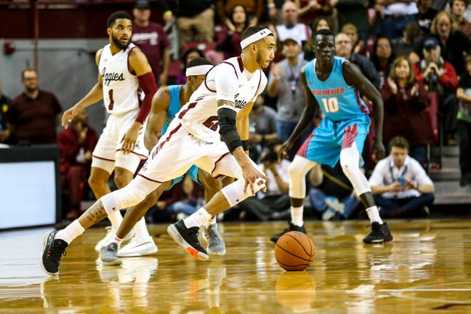 The NMSU Aggies face off against the UNM Lobos at the Pan American Center in Las Cruces on Thursday, Nov. 21, 2019.
