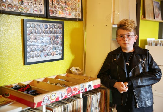 Jackson Tyskewicz, 10, sells patches, stickers and pins inside his father's shop at Eyconik Records and Apparel.