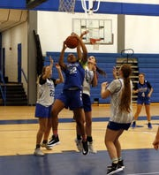 Carlsbad freshman Aaliyah Jones (32) gets a rebound over sophomore Morgan Boatwright during practice on Nov. 19, 2019. The Cavegirls open their season on Dec. 2 in El Paso against Americas.
