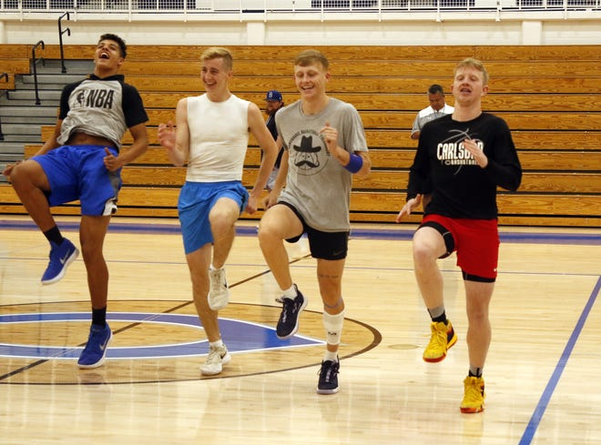 Left to right: Tylen Gonzalez, Evan Sullivan, Riley Hestand and Andrew Miller do high-knee warmups during practice on Nov. 19, 2019. The Cavemen have a scrimmage against Goddard on Nov. 26 and open their season on Dec. 3 at home against El Paso Americas.