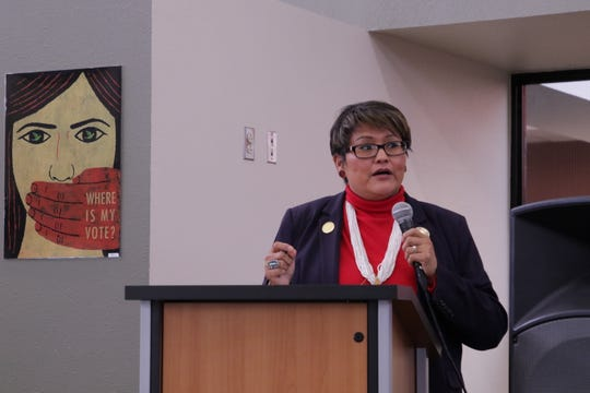 Navajo Nation Council Delegate Eugenia Charles-Newton talks about obstacles Native Americans can experience when registering to vote during a Nov. 21 forum at San Juan College in Farmington.