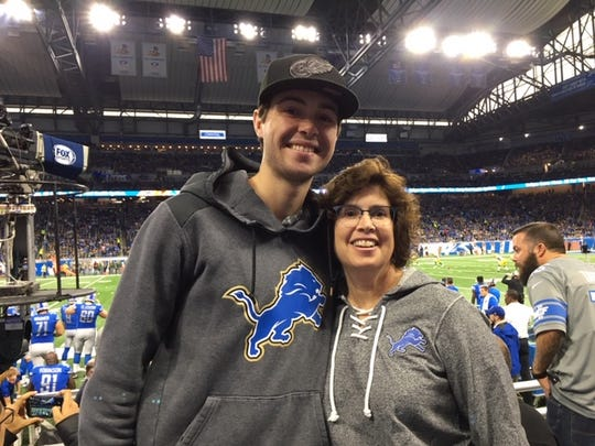 Denise Harting with her son, Aaron Harting, at Ford Field.