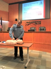 Farmington Hills Emergency Medical Services Coordinator James Etzin demonstrated how to rub a chest to check a person's consciousness during Thursday, Nov. 21, 2019 Narcan training at Farmington Hills City Hall.