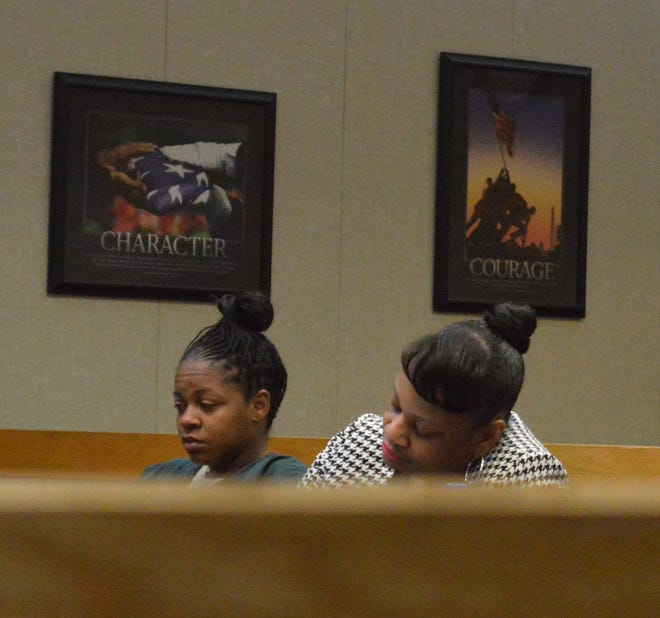 Accused of murdering her daughter and abusing both her daughter and son, Steffani Jones, to the left, sits with her attorney Lillian Diallo.
