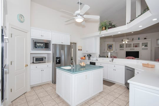 The chef's kitchen includes stainless appliances.