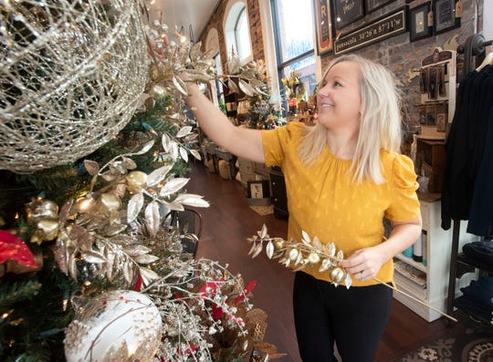 Samantha Breedlove decorates the Rusted Arrow Mercantile for the holidays on Nov. 22. The shop is now in its third year at its home on Palafox Place.