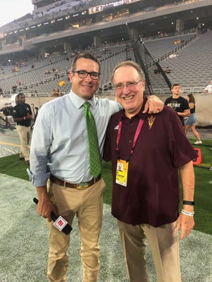 ESPN's Tom Luginbill, left, grew up in football around his father Al, now back at Arizona State for a third time as director of player personnel.