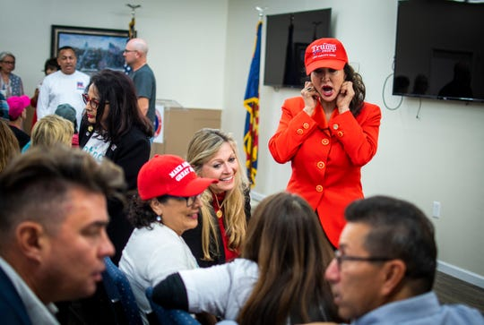 People mingle before the Trump Victory Leadership Initiative training at the Arizona Republican Party Headquarters in Phoenix on Thursday, Nov. 21, 2019.