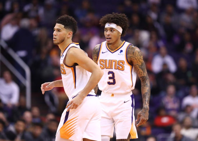 Nov 21, 2019; Phoenix, AZ, USA; Phoenix Suns guard Devin Booker (left) and forward Kelly Oubre Jr. against the New Orleans Pelicans at Talking Stick Resort Arena. Mandatory Credit: Mark J. Rebilas-USA TODAY Sports