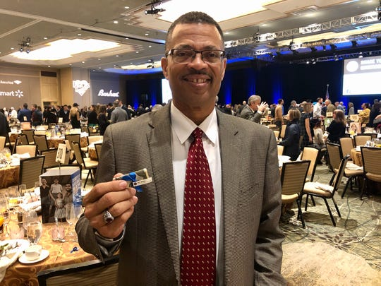 Stacy Anderson said a $20 bill at his place setting to give to someone else made him think about what else he could do to help.