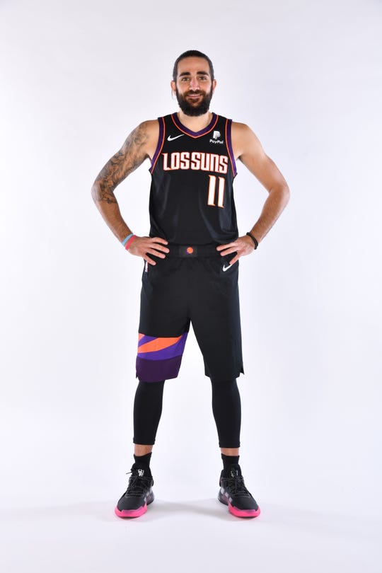 Ricky Rubio shows off the Phoenix Suns' newest uniform.