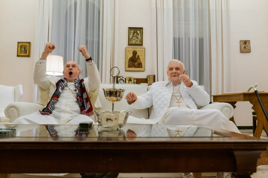 """Jonathan Pryce (left) and Anthony Hopkins star in """"The Two Popes."""""""