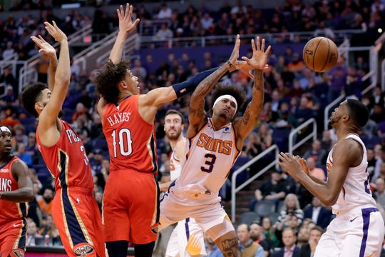 Phoenix Suns forward Kelly Oubre Jr. (3) loses the ball as New Orleans Pelicans center Jaxson Hayes (10) defends during the second half of an NBA basketball game Thursday, Nov. 21, 2019, in Phoenix. (AP Photo/Matt York)