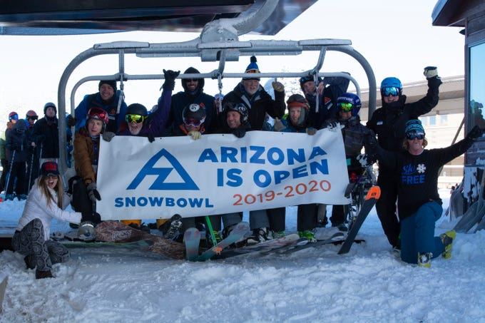 Snowboarders arrive at Arizona Snowbowl on the mountain's opening day in Flagstaff on Nov. 22, 2019.