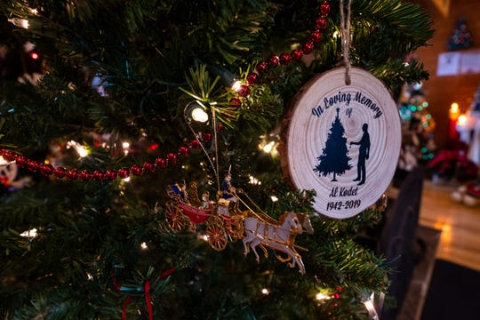 A Christmas ornament in memory of Al Kodet hangs on a tree in his former Clay Township home, where the annual History of the Christmas Tree Walk is held. The ornaments were made and handed out to his family at his memorial service.