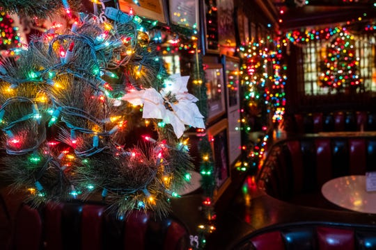Christmas decorations hang on the wall at Brass Rail in downtown Port Huron.