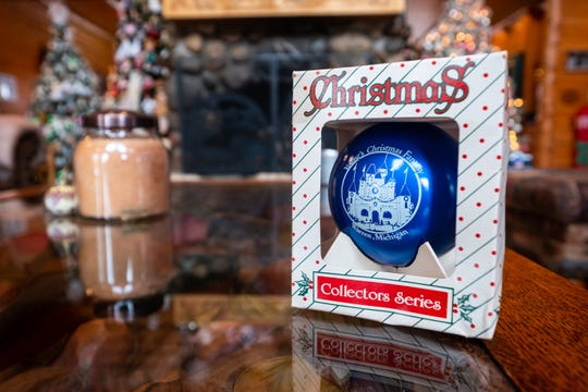 The last Christmas ornament purchased by Al Kodet sits on a table in the living room of his former Clay Township home. The ornament was found by his wife Diane Kodet after he died in September.