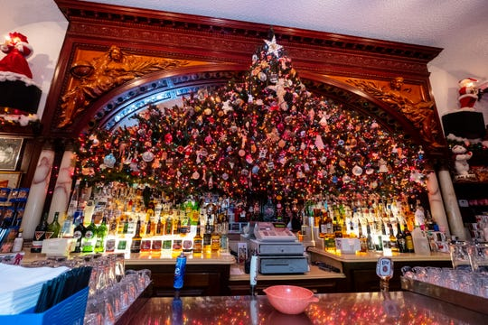 A Christmas tree hangs behind the bar at Brass Rail in downtown Port Huron.