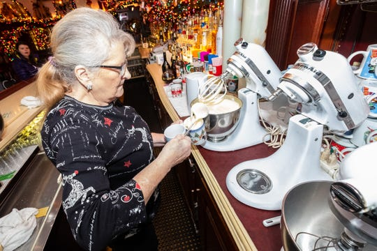 Sue Dunn, manager at Brass Rail in downtown Port Huron, works to make a Tom and Jerry Friday, Nov. 22, 2019.