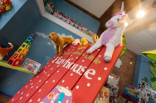 Melissa & Doug toys hang from a beach chair inside The Curious Little Playhouse in downtown York on Wednesday, Nov. 20, 2019.