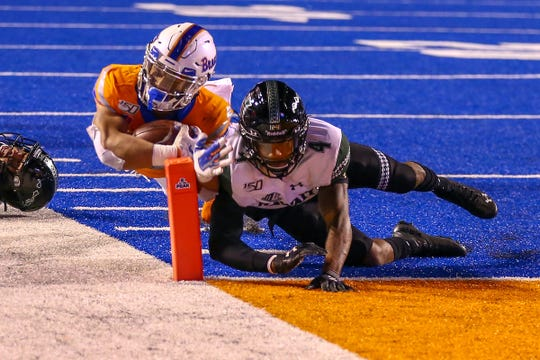 Boise State running back George Holani (24) scores a touchdown against Hawaii during the teams' game earlier this season.