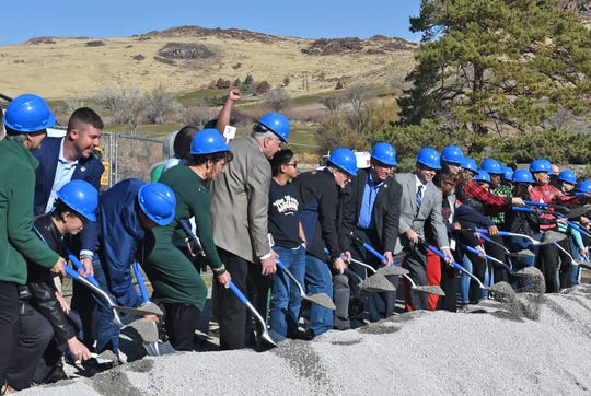 Officals, teachers and students break ground on the new Proctor R. Hug High School at the Wildcreek Golf Course on Friday Nov. 22, 2019.