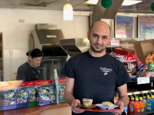Zaid Lakees serves baklava and Turkish coffee at Anthony's.