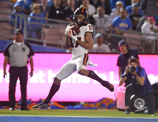Oct 5, 2019; Pasadena, CA, USA; Oregon State Beavers wide receiver Isaiah Hodgins (17) catches a pass for a touchdown in the second half against the UCLA Bruins at the Rose Bowl. Mandatory Credit: Jayne Kamin-Oncea-USA TODAY Sports