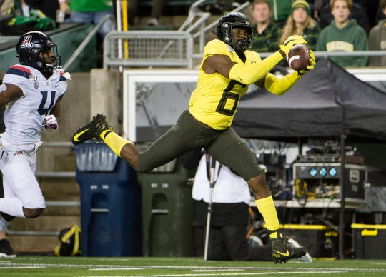 Nov 16, 2019; Eugene, OR, USA; Oregon Ducks wide receiver Juwan Johnson (6) catches a touchdown pass during the first half against the Arizona Wildcats at Autzen Stadium. Mandatory Credit: Troy Wayrynen-USA TODAY Sports