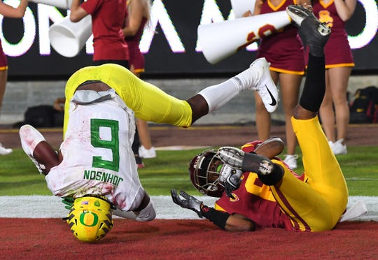 Nov 2, 2019; Los Angeles, CA, USA;    Oregon Ducks wide receiver Juwan Johnson (6) hangs on to a pass as he gets past USC Trojans cornerback Isaac Taylor-Stuart (6) for a touchdown in the second half of the game at the Los Angeles Memorial Coliseum. Mandatory Credit: Jayne Kamin-Oncea-USA TODAY Sports