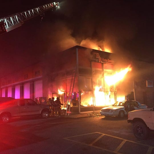 Firefighters combat a structure fire at PNR Auto Center on Thursday, Nov. 21.