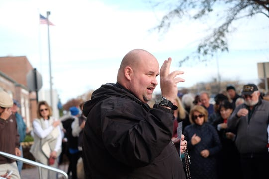The Rev. William Cocco of St. Edmond's Catholic Church prays the rosary with over 150 Christians on Thursday in protest of Rehoboth Beach's decision to prohibit Nativity scene displays on city property.