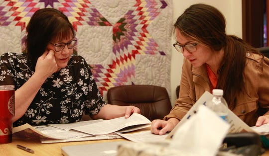 Julie Garreau, founder and director of the Cheyenne River Youth Project, at left, works closely with program staff members, including Deputy Director Meghan Tompkins, to help Native American youths in and around Eagle Butte to develop job, artistic and life skills that will help them succeed in life.