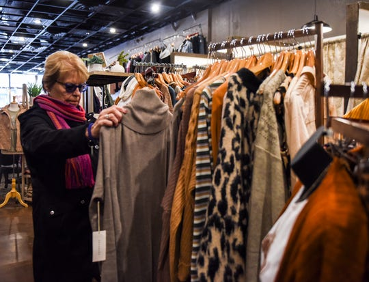 Betty Crim shops for Christmas presents at Chelsea's Boutique on Friday, Nov. 22, 2019, in downtown Sioux Falls.