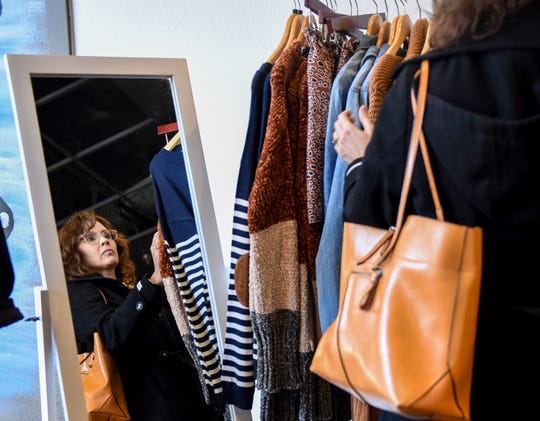 Joan Hanson shops at Chelsea's Boutique on Friday, Nov. 22, 2019, in downtown Sioux Falls. Hanson says the boutique is one of her daughter's favorite stores.