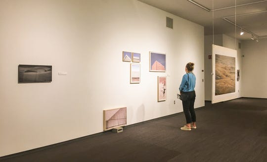 A patron looking at works in Land of Plenty, a photography exhibition of South Dakota artists at the Visual Arts Center, Washington Pavilion.