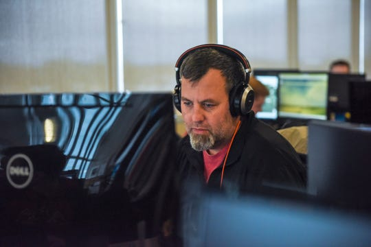 System architect Zach Conrad works at his desk on Thursday, Nov. 21, 2019, at Farmers Business Network in Sioux Falls, S.D. Conrad believes there is a pool of tech talent in Sioux Falls.
