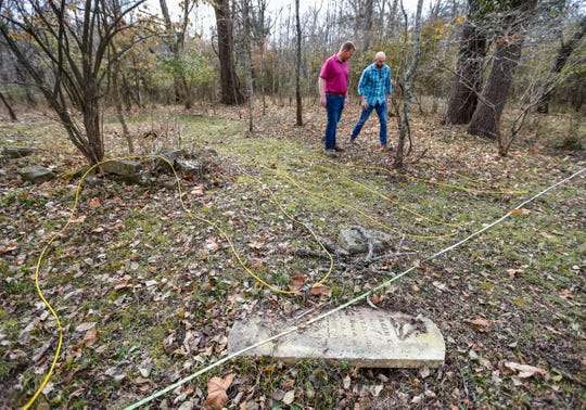 Electrical equipment used to survey an abandoned lead mine in eastern Greene County weaves its way through an old family cemetery on Wednesday, Nov. 20, 2019.