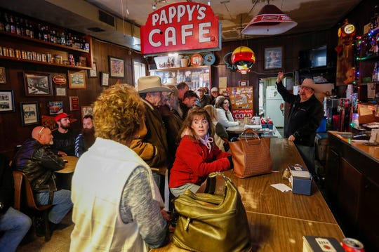 Mike Easterly, right, of Easterly Auction Company, auctions off Pappy's Cafe on Friday, Nov. 22, 2019. The property sold for $75,000.