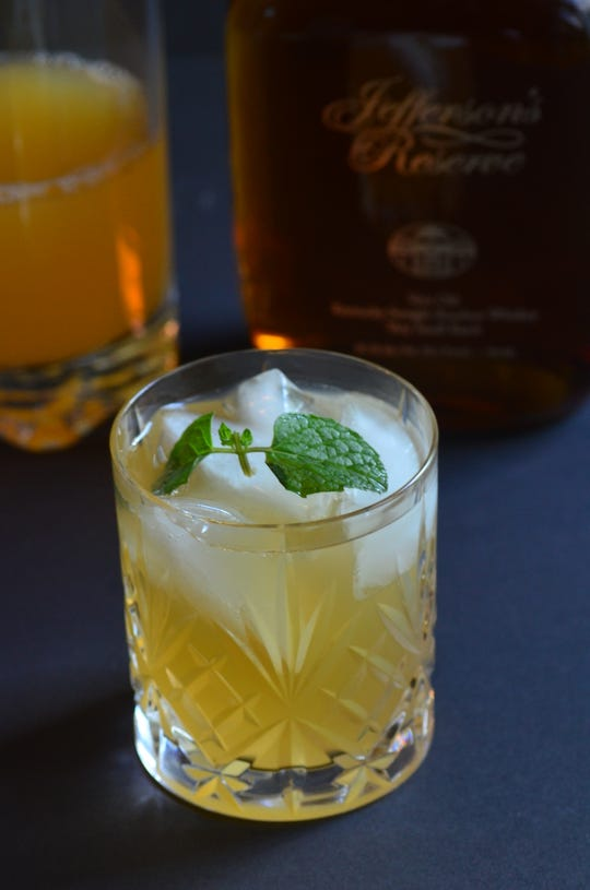 Get a good quality bourbon to make the Peach Mint Julep recipe.