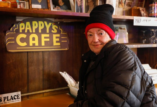 Longtime Pappy's customer Marsha Langley stands behind the bar after the historic restaurant was auctioned off on Friday, Nov. 22, 2019. The new owner plans to continue operating the cafe.