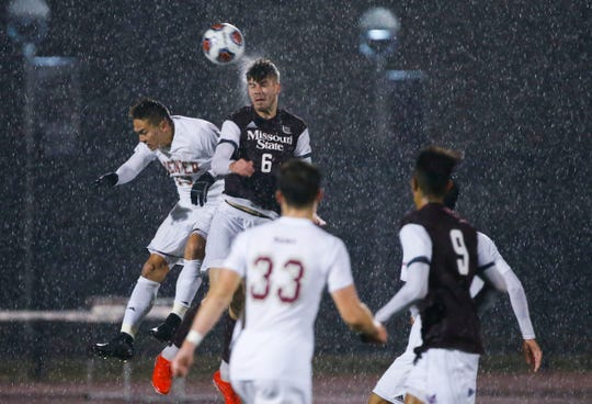 Missouri State defender Ben Stroud heads the ball as Denver's Josh Drack competes for the ball during a first round NCAA Tournament game on Thursday, Nov. 21, 2019.