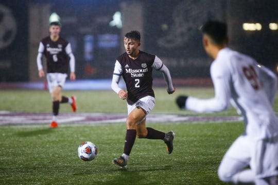 Missouri State Bears defender Connor Langan drives downfield with the ball during a first NCAA Tournament game against the Denver Pioneers at Missouri State University on Thursday, Nov. 21, 2019.