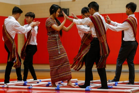 Students perform a traditional Burmese dance during an assembly at Pershing Middle School on Friday, Nov. 22, 2019.