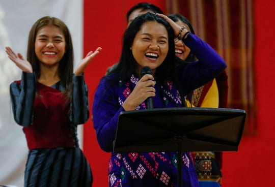 Sung Par laughs as she gives a presentation on Burmese culture during an assembly at Pershing Middle School on Friday, Nov. 22, 2019.
