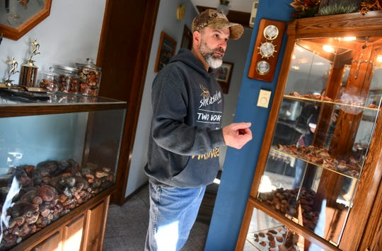 Lyndon Johnson talks about the history behind his collection of locally-discovered agates Friday, Nov. 22, 2019, at his home in Sauk Rapids.